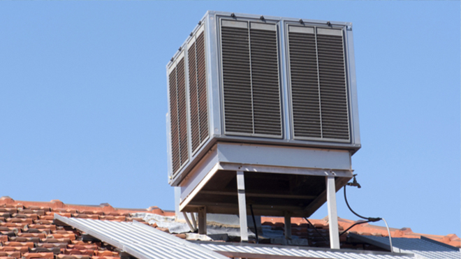 How do evaporative coolers and air conditioners differ?